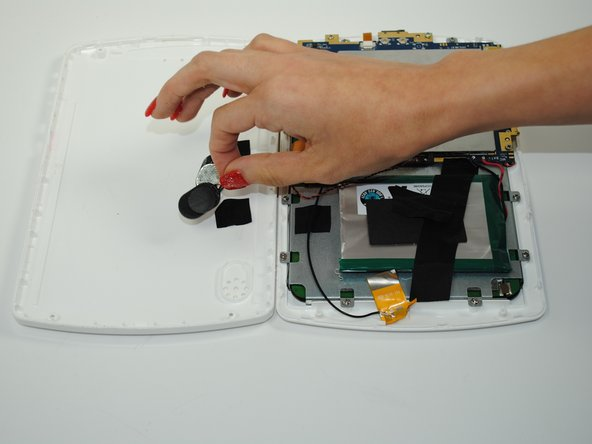 Remove the electric tape holding the wires of the speakers in place and gently pull the speakers out of their slots in the device.