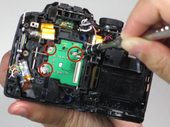 Use a PH00 screwdriver to remove the three 3mm screws holding the image sensor down.