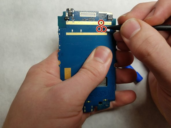 Detach the camera completely by using the spudger tool to poke through the camera attachment holes.