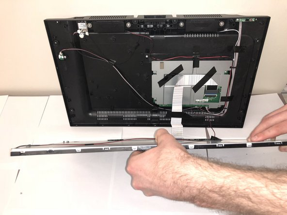 Then carefully remove metal backing from glass screen and separate the layer of plastic from the glass screen.