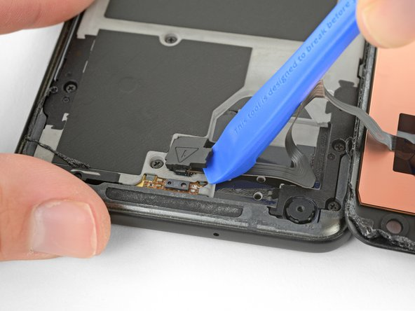 Pry carefully to avoid damaging the cable underneath, or losing the cover itself.