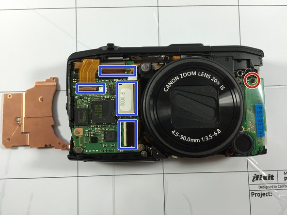 After removing the whole chassis of the camera. make sure you all the tabs are undone from the motherboard