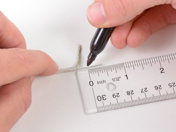 "Image 1/1: Use a pen to make a mark about 3/8"" (1 cm) away from the end of the inner wire."