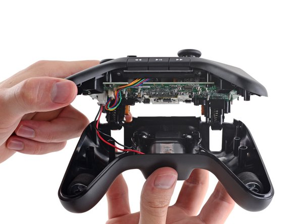 Image 2/3: The controller is tamper-proofed with a variant of the tri-wing screw family. They look cool and resemble [http://theawesomer.com/photos/2009/09/091009_shuriken_2.jpg|shurikens|new_window=true], but we don't know anybody who keeps a shuriken driver on their tool belt.