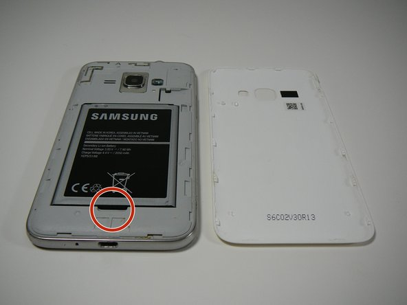 "Once the cover is removed you'll find the battery that reads ""SAMSUNG"""