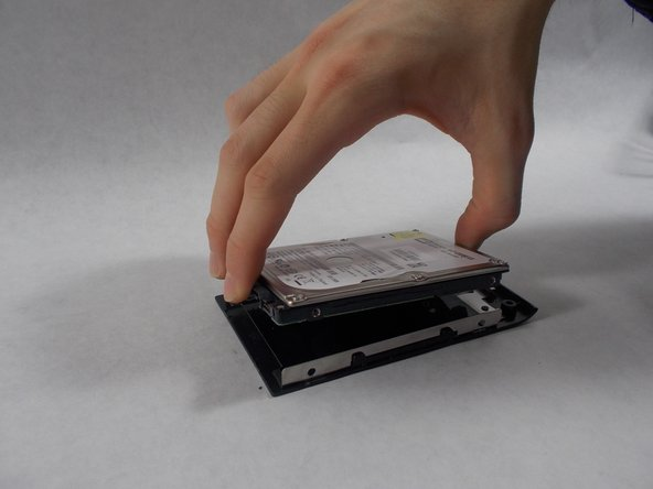 Lift the hard drive up from the plastic cover.