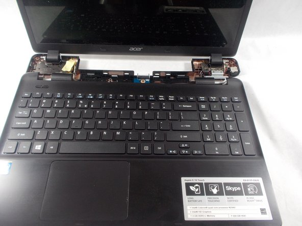 Flip over the laptop, Using the spudger separate the body of the keyboard from the base of the laptop.