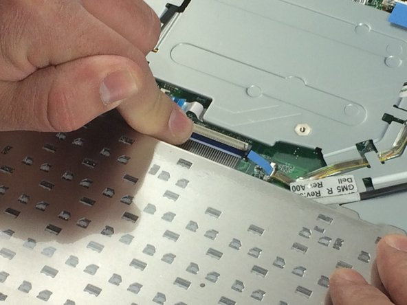 Remove the ribbon cable as shown