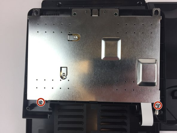 Place the video screen face down to expose the two screws. The screws are indicated by the red circles.