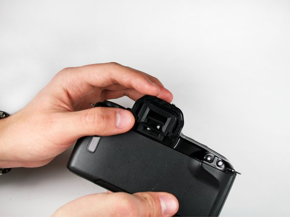 Grasp the eyepiece with your fingers and slide upwards to remove it.