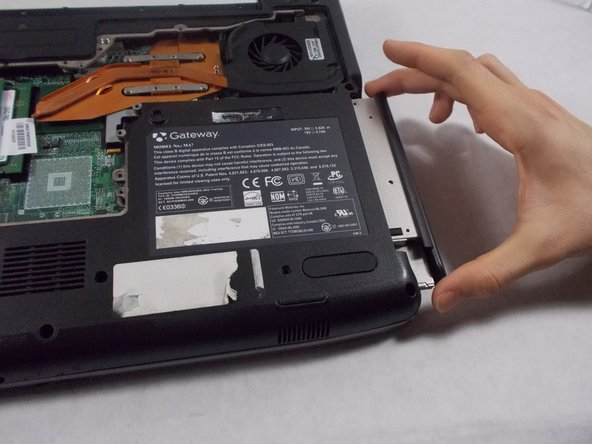 Once the drive has been pried out, you can pull the CD drive out.
