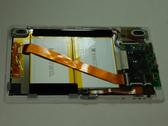 Image 2/2: Insert the plastic opening tool between the front case and rear panel. Use a prying motion to lift the front case from the rear panel.