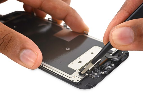 Use a pair of tweezers to peel up the piece of tape from the EMI shield, near the front camera housing.