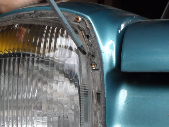 To do so, locate the screws on the headlamp cover body, which are covered with a plastic frame. The outer-side screw aligns the fog lamp and the inner-side screw aligns the headlamp. Start your car,  turn on the fog lamps, and align them; then, turn off the fog lamps and align the headlamps.