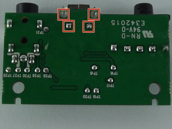 Use the soldering iron to heat up solder joint and desoldering wick to remove the solder on  each solder pad.