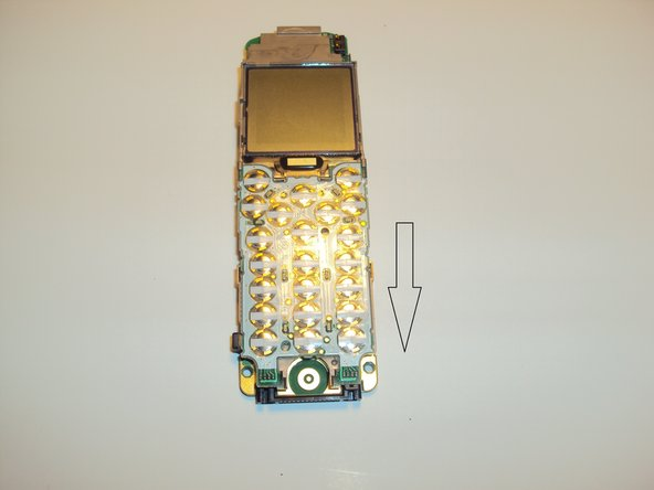 To remove keyboard circuit press on the middle and slide down. The board will pop up allowing for removal.