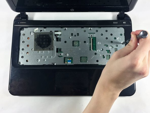 Unscrew the 10 6.0 mm screws under the keyboard housing with a Philips #0 head screwdriver.