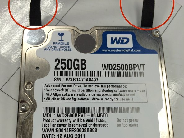 Slide hard drive out by pulling gently on the felt handle