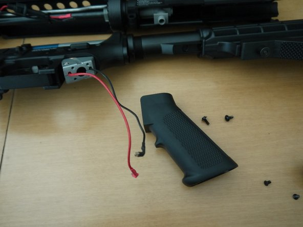 Pull the pistol grip off, and be careful when guiding the wires out.