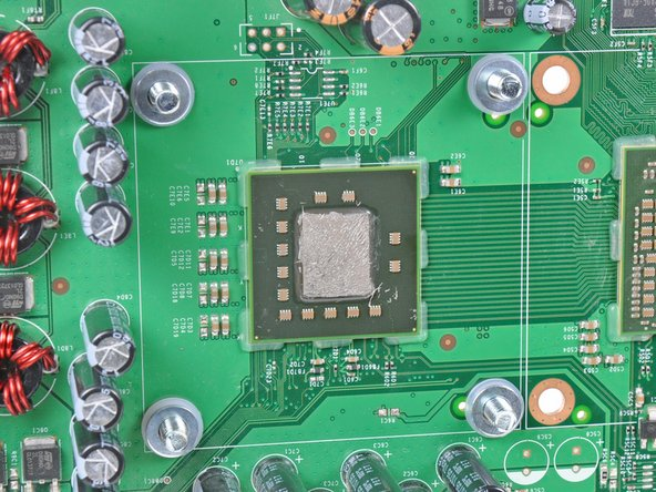 Image 1/3: Insert a machine screw through each of the four holes around the CPU heat sink, with their heads on the back side of the board.