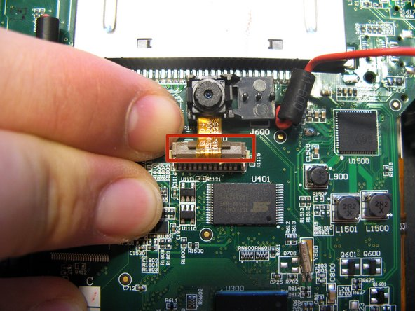 To safely remove the ribbon cable, first you must pull up the retaining flap.