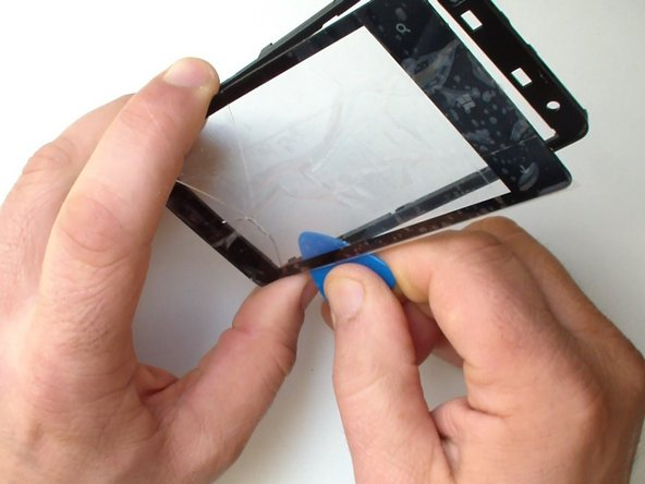 Image 1/3: Install the new touch screen and start to reassemble the device.