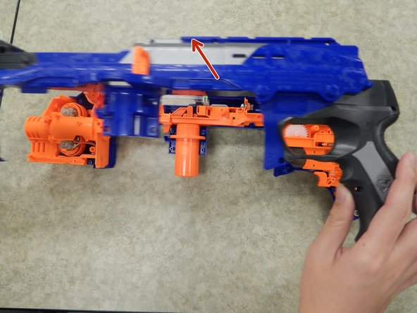 Completely remove the left shell from the rest of the Nerf Gun.