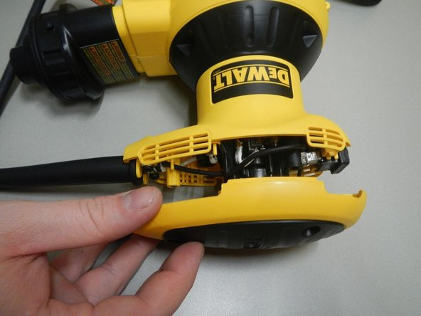 Once cap is off, expose and locate the power cord mounting bracket and remove the 2 screws holding the wire down by using the T15 torx attachment.  Once the cord is loose, pull the connectors out