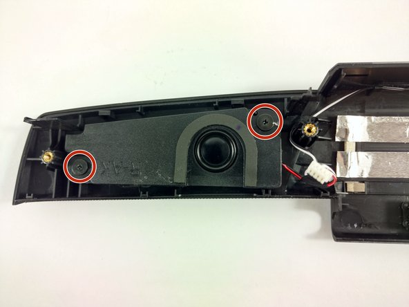 Remove the two 2.8mm screws on the right speaker housing using a Phillips screwdriver.
