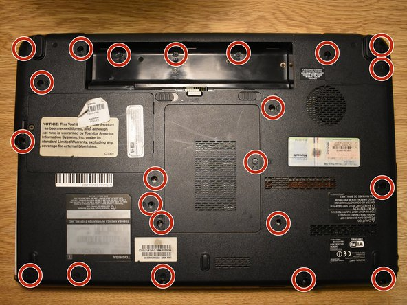Unscrew all of the screws marked on the underside of the laptop.