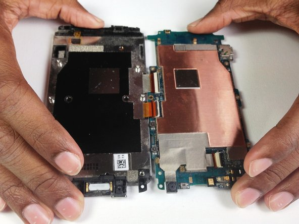 Image 1/2: If there is resistance pulling apart the phone then a ribbon or tab has not been disconnected properly/completely.