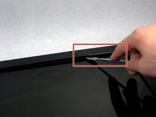 Do not put the metal spudger between the metal and the glass. It needs to go under the bezel and above the metal.