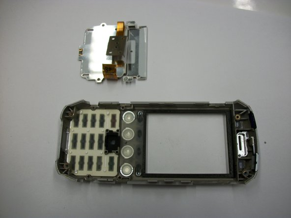 Remove the keypad protector and connector from the faceplate.