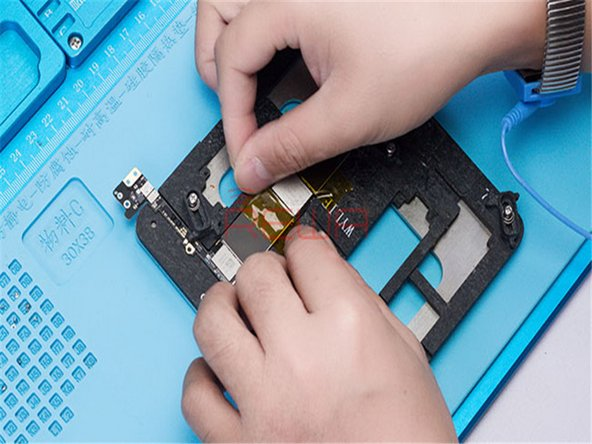 Take apart the phone. Take out the logic board and then attach the logic board to PCB Holder.