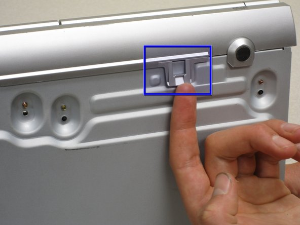 Image 3/3: If you are having trouble removing the panel, try wedging an object underneath the two clips on the bottom to keep them from falling back into place.