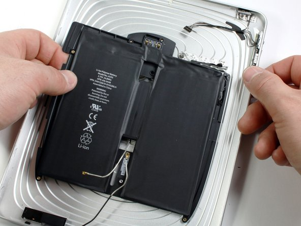 Image 1/2: Remove the battery from the rear panel.