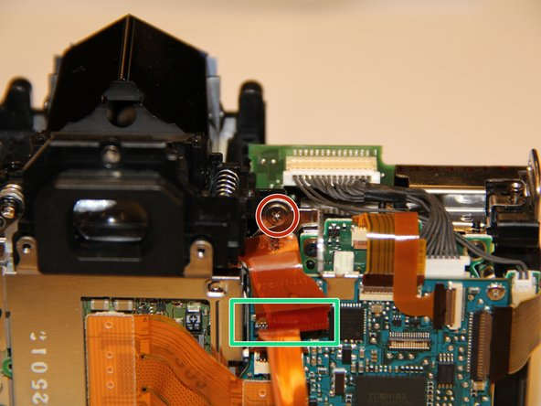 Image 1/2: Remove this screw.