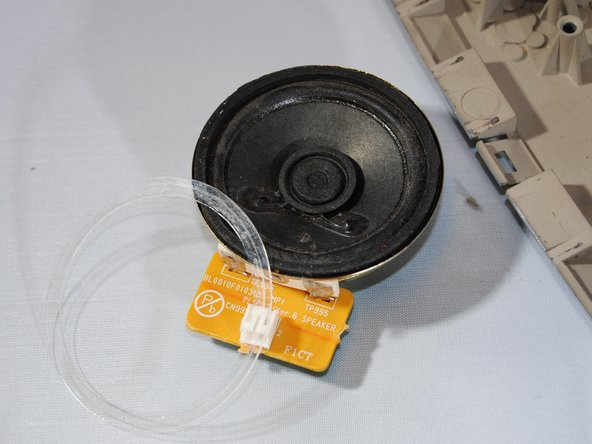 Lift the speaker out of its holding.