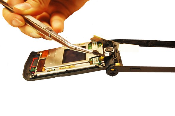 Once the screws and upper casing have been removed, locate where the camera attaches to the upper circuit board and detach it using a pair of tweezers.