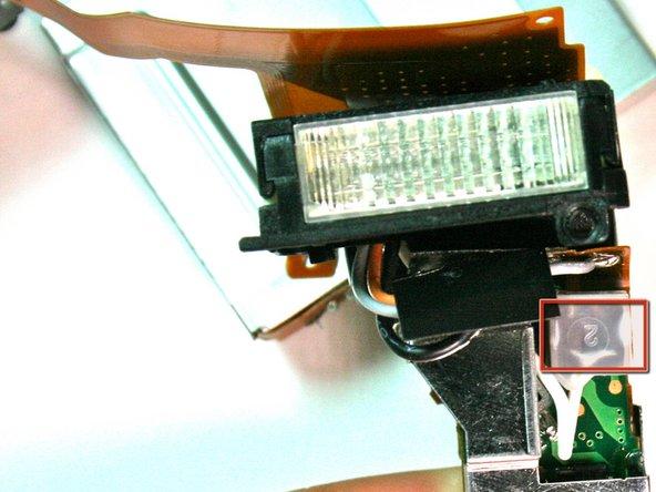 Image 1/2: Desolder the white wire.