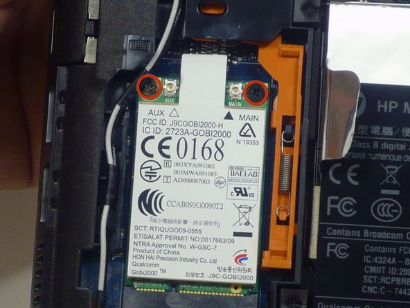 Use a phillips #00 screwdriver to remove the 2 phillips 2.0 and 3.0 mm screws that secure the WWAN to the system board.