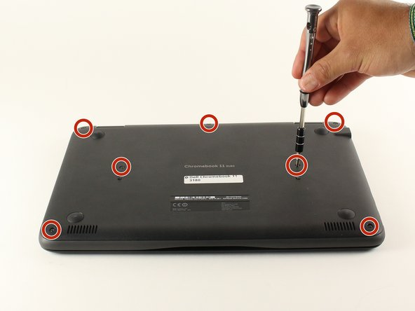 Using a Phillips #0 screwdriver, loosen all seven 2.5mm screws on the back cover of the device.