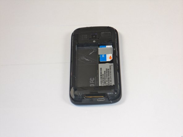 Image 1/3: Slide out SIM card rest of the way with your finger.