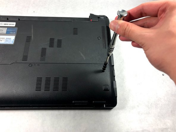Use a Phillips #000 screwdriver to remove the two 9mm screws from the HDD/RAM cover panel.