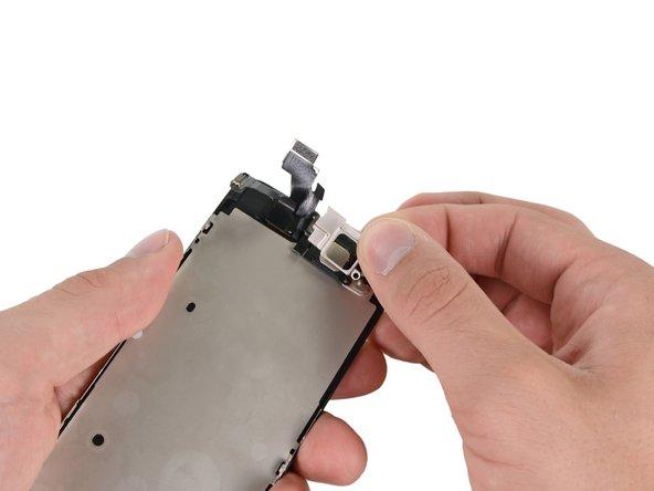 取下用于固定听筒的铁片小挡板。