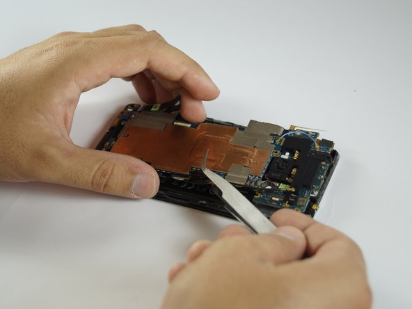 Remove the motherboard completely out of the phone.