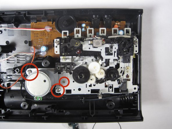 Remove the screws as indicated in the picture using the Phillips Head screwdriver.