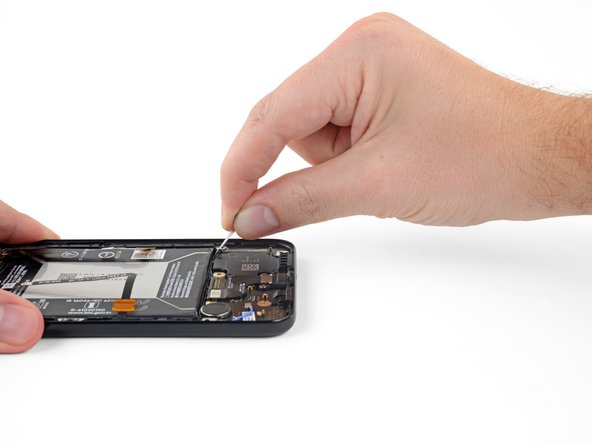 Grab the right adhesive tab and slowly pull it away from the battery, toward the bottom of the phone.