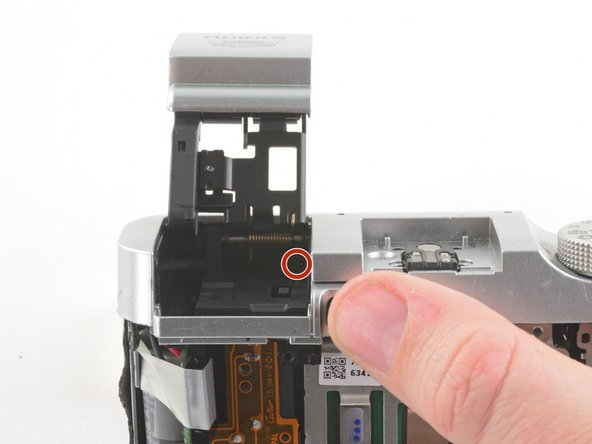 Remove the 3.4 mm Phillips screw in the back of the flash compartment.