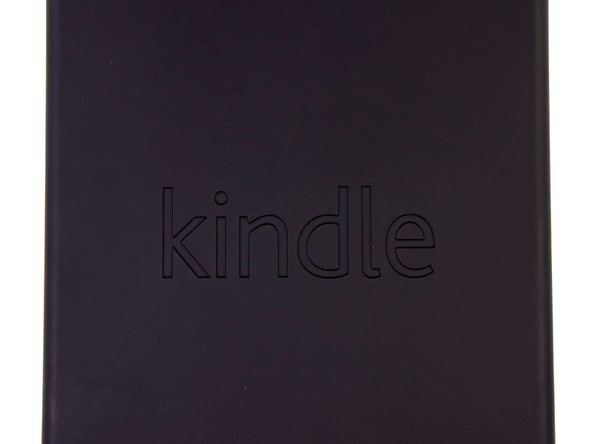 "Image 1/2: In case you couldn't identify the Kindle Fire by its sleek looks, the back panel has been stylishly embossed with ""kindle."" The smooth, rubberized texture of the panel complements the small size quite well to provide a nice feel when holding the Fire in one hand."